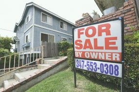 """A """"For Sale by Owner"""" sign is posted in front of property in Monterey Park, California, last year. After record lows throughout 2020 and to start this year, mortgage rates are expected to increase this year."""