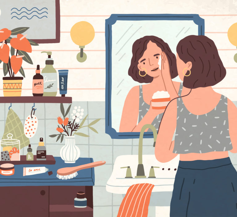 woman putting lotion on her face in the mirror
